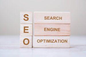 SEO (Search Engine Optimization) text wooden cube blocks on tabl